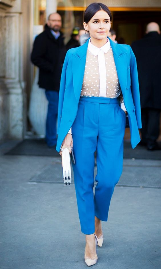 Play with Contrast - Pair a simple top with a bold suit set to break up the monotony and be more approachable