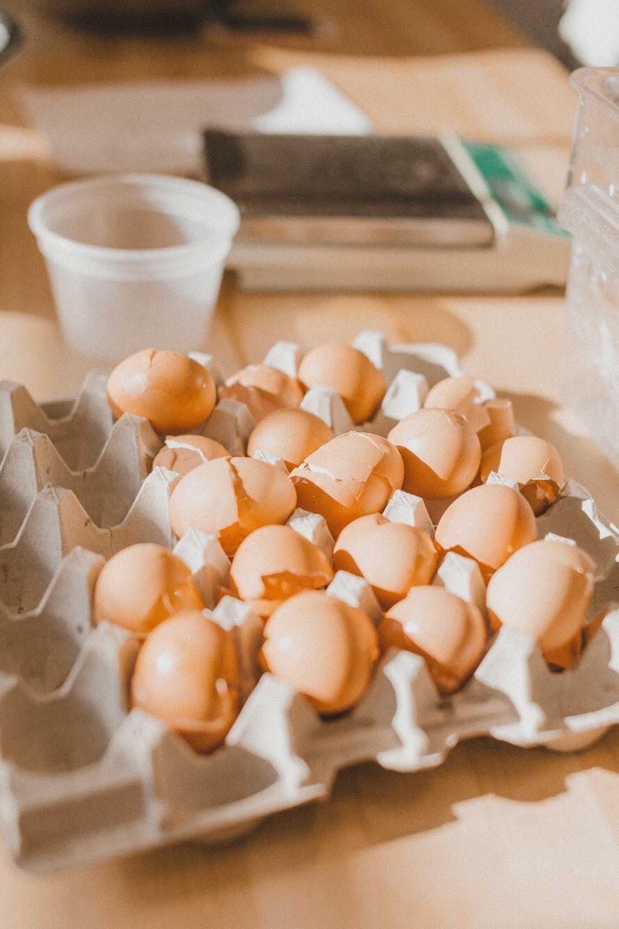 cracked eggs in carton.JPG