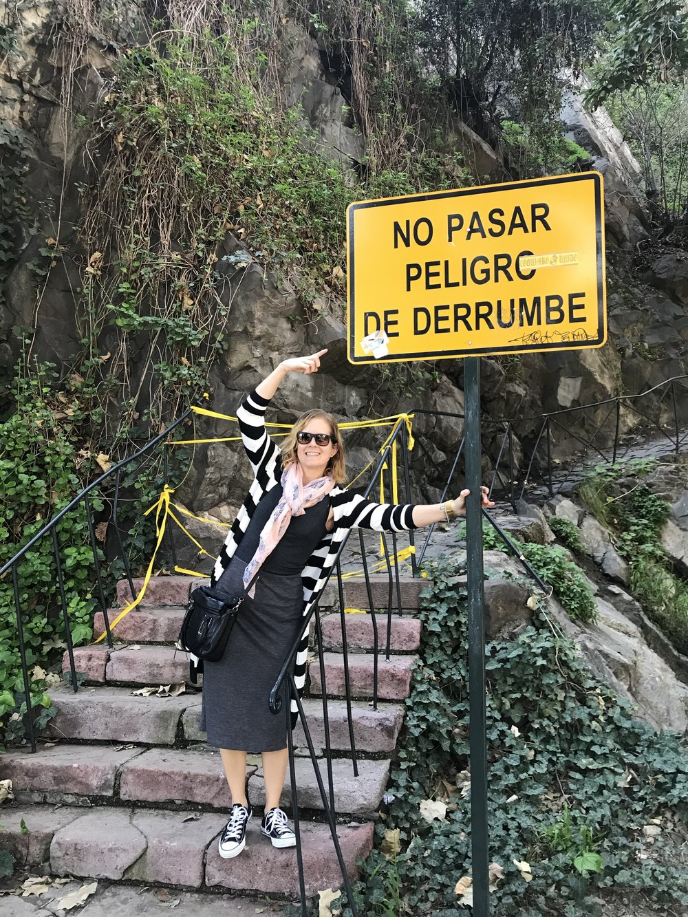 """Posing on the stairs with the sign that says """"don't walk through here"""""""