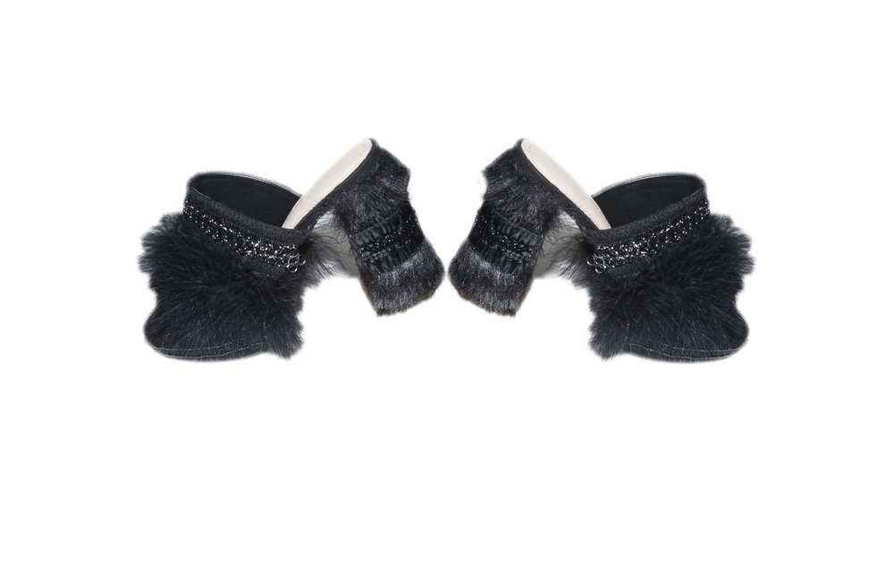 In need of evening shoes, San Martin added fur, feathers and embroidery to decorate these store bought heels after being invited to a last minute event.