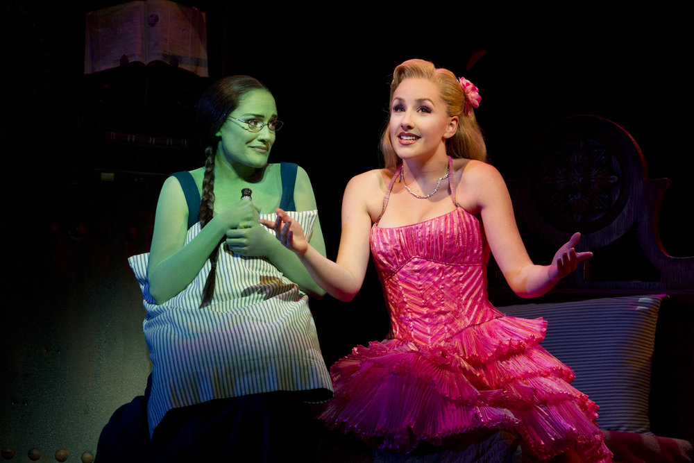 Photo by Joan Marcus | Elphaba (Christine Dwyer) learns how to be popular from Glinda (Jeanna de Waal).