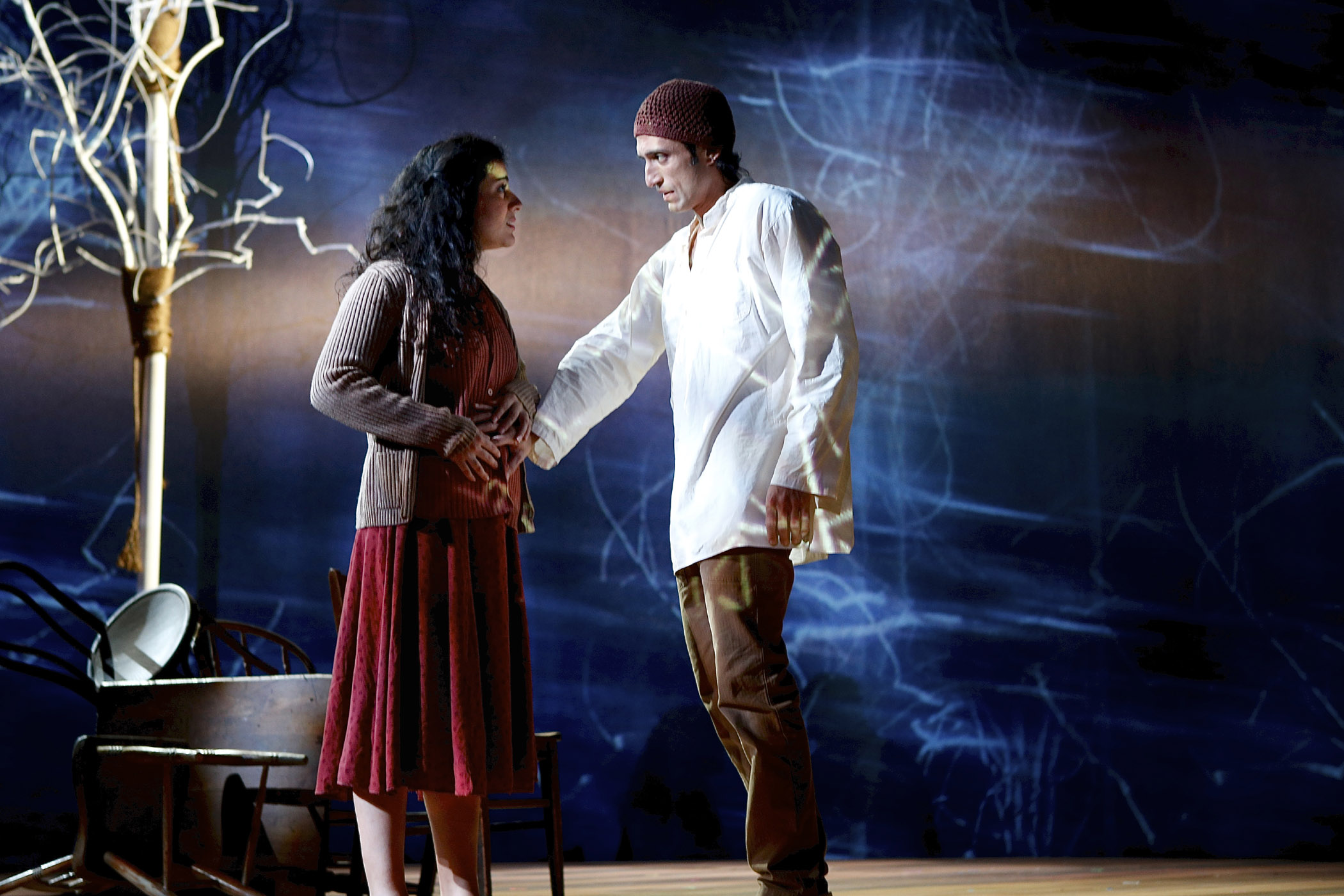 Nadine Malouf (Nawal) and René Millán (Wahab/Nihad) in the Syracuse Stage production of Scorched. Photo by Michael Davis
