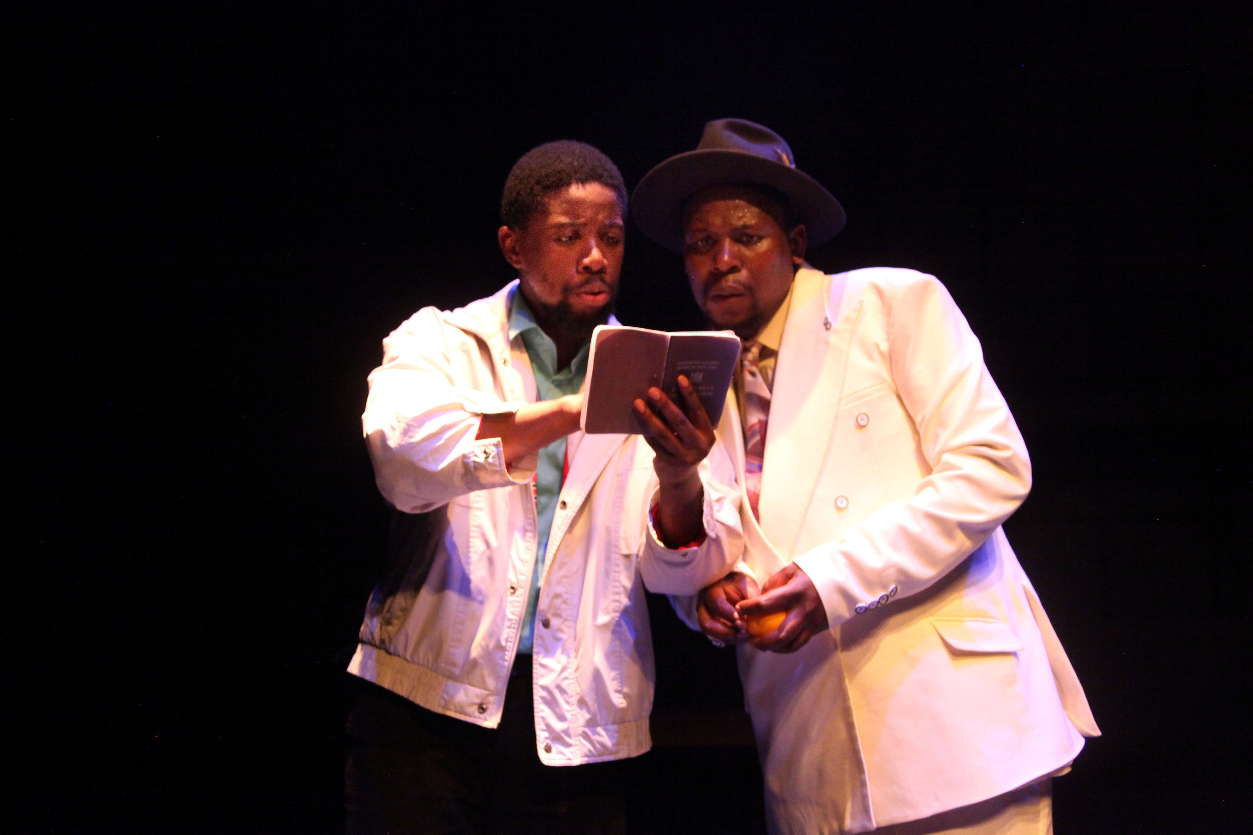 Atandwa Kani and Mncedisi Shabangu in the Syracuse Stage production of Sizwe Banzi is Dead. Photographer Ruphin Coudyzer.