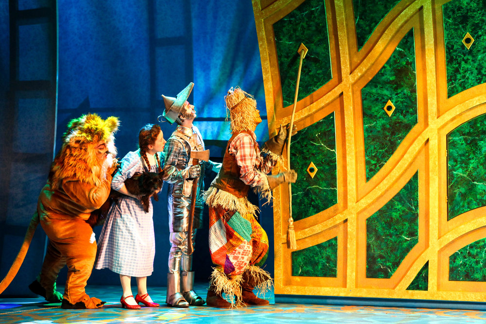 "Brian Michael Hoffman, Kate Jarecki, Tucker Breder, and Crawford Horton in Syracuse Stage's production of ""The Wizard of Oz."" Photo by Michael Davis."