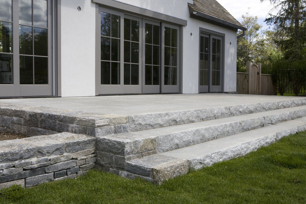 IMPERIAL GREY GRANITE STEPS WITH A CUSTOM GAULT STONE VENEER STONE BLEND ON EDGES