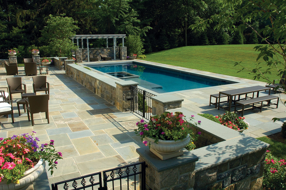 MATERIALS USED: FULL RANGE, NATURAL CLEFT BLUESTONE PATIO; CT FIELDSTONE, SQUARE CUT WALLS; BLUE, THERMAL BLUESTONE WALL CAPS