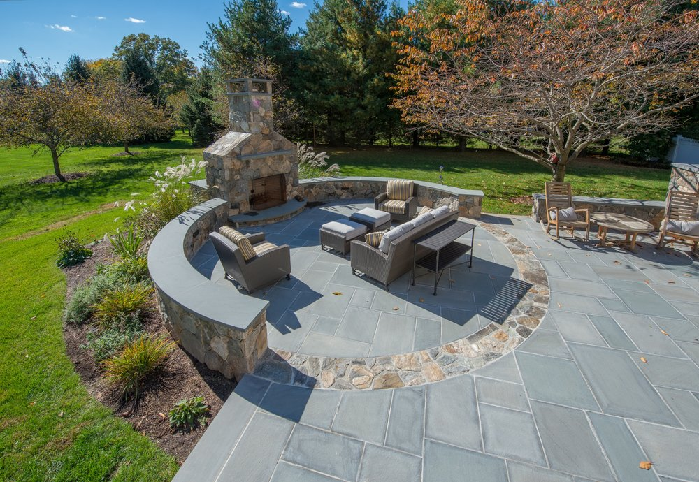 MATERIALS USED: CT FIELDSTONE, MOSAIC CUT FIREPLACE AND WALLS; BLUE, THERMAL BLUESTONE WALL CAPS; BLUE, THERMAL BLUESTONE PATIO