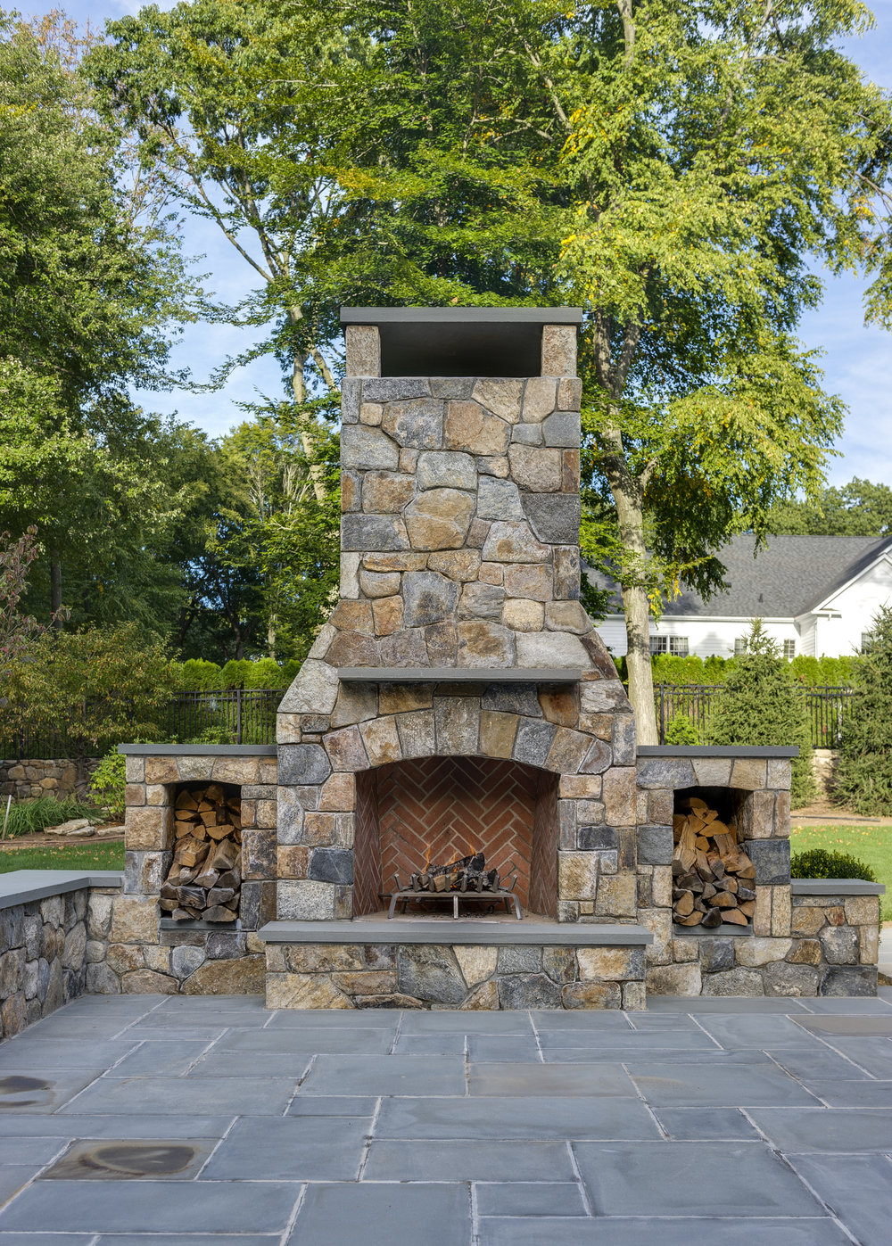 MATERIALS USED: CT FIELDSTONE, MOSAIC CUT FIREPLACE; BLUE, THERMAL BLUESTONE HEARTH
