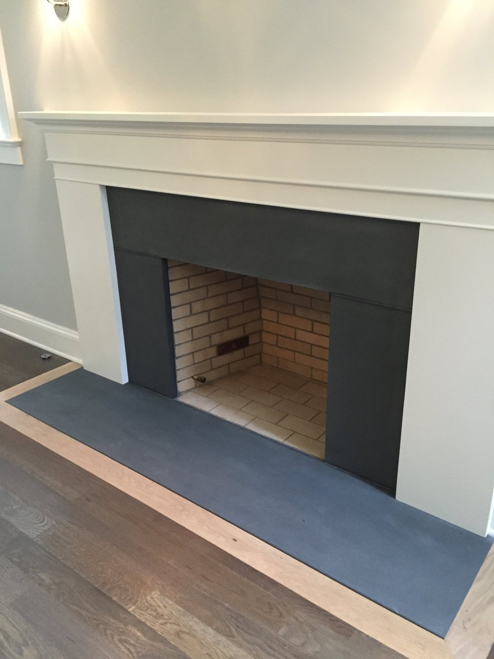DARK BLUESTONE FIREPLACE SURROUND AND HEARTH, HONED