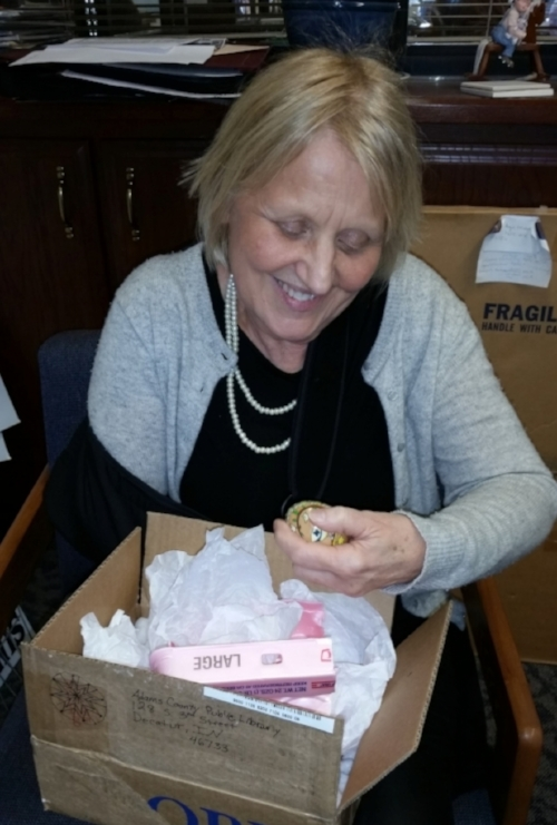 A staff member at the Adams County Public Library unpacking my egg.