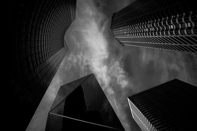 Ground Level #seattle #downtown #urban #architecture #building #design #blackandwhite #monochromatic #darksky #silhouette #standingtall #igmasters #city #bw #bw_photooftheday #ig_bw #dark #mood #reflection #skyscraper #architecturephotography #concretejungle #cityscape #cityphotography #washingtonstate #seattlewashington #lookingup_architecture #sky #tower #ajwilliamsphoto