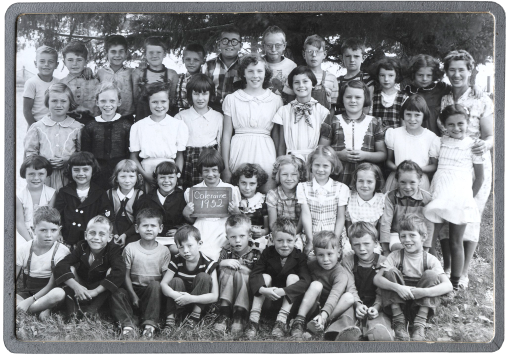 Students at the one room school house. Doug is at the top row, 2nd from the left.