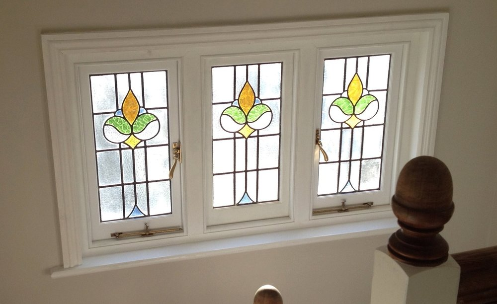 Casement window with stained glass