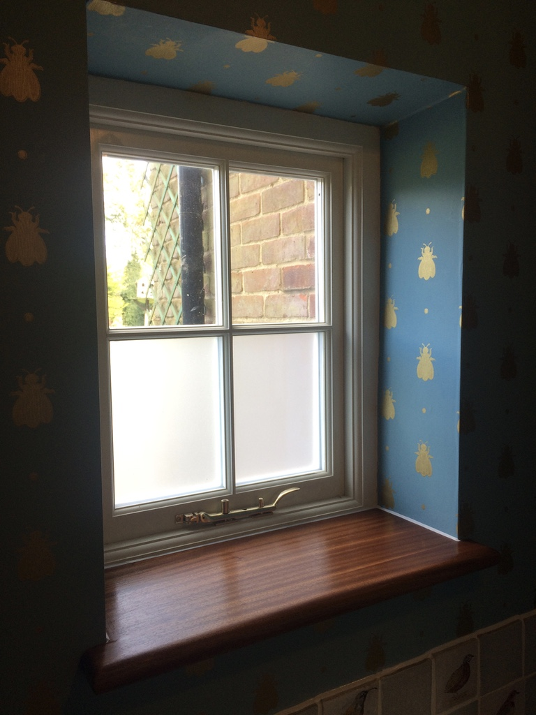 A partly frosted glass window for a bathroom