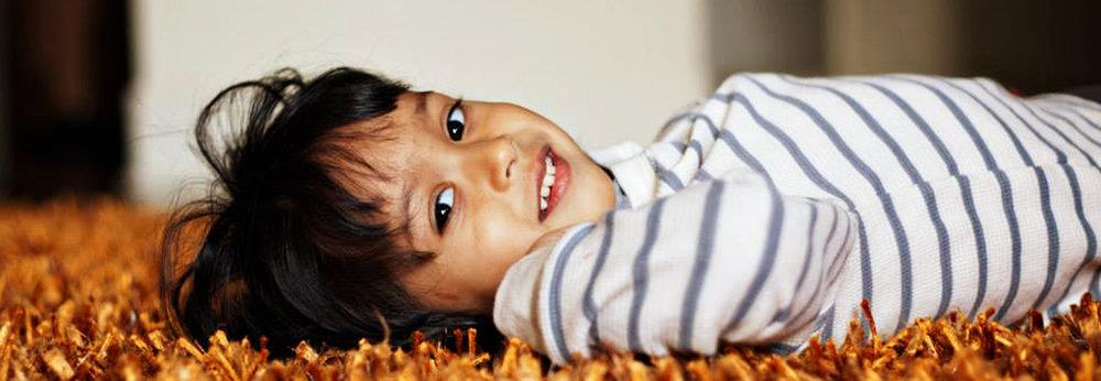 boy_on_orange_carpet.jpg