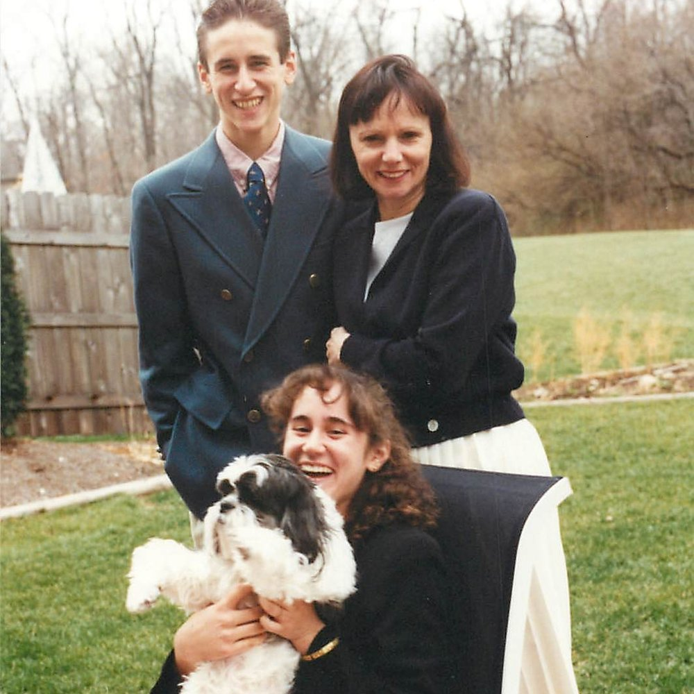 High school with our family dog, Ritz.  Look at that hair!.jpg
