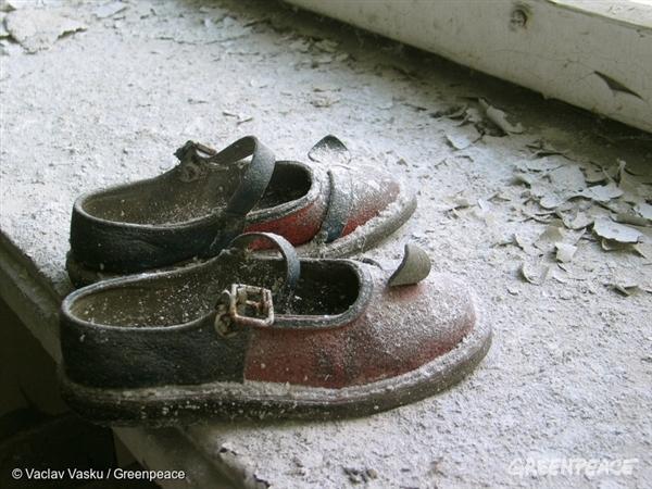 Abandoned baby shoes in Pripyat's kindergarten.