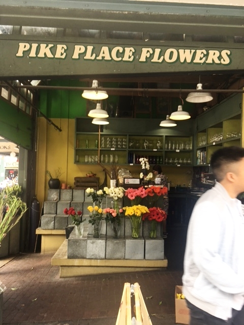 We started walking in towards the market and saw this cute little corner shop with flowers.