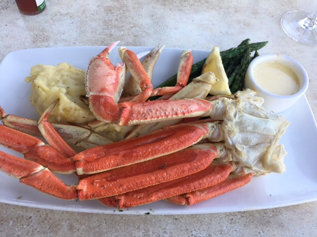 "Steamed ""Dungeness crab legs"" with mashed potatoes and asparagus."