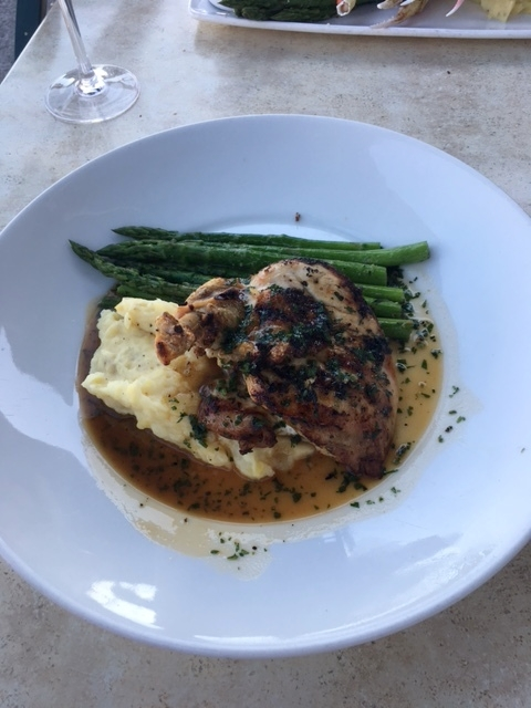 """Bone-in Grilled Chicken"" with mashed potatoes and asparagus."