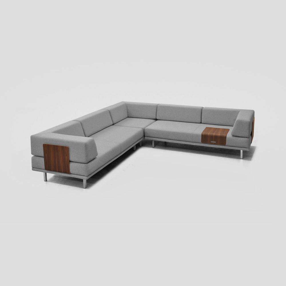 Clip Sofa   Client: Fab 2014  Clip is a configurable sofa system. It consists of 5 modular parts that you can use build your own sofa in hundreds of variations.   The system features a patent pending removable back support system.  The bent plywood back support easily clips in and out of position and can be used for various other functions such as a tray for resting your drink.  The same mechanism used for locking the back support in place also serves to connect base units to lock you configurations in place.