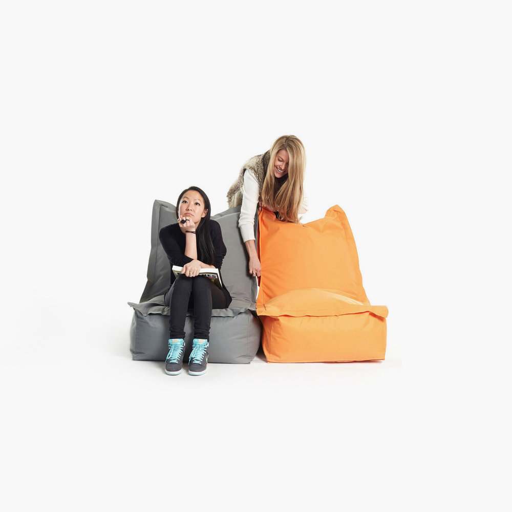 Link Chair   Client: Fab 2014  This beanbag chair is breaking out of the basement to make its living room debut. Approaching it as a true chair—not just a cushy crash pad, Clabots developed an upright, ergonomic silhouette that retains the sink-into-it quality that makes beanbags, well, the best. An extended fabric edge frames the back and seat, crisply delineating the chair's sophisticated shape while concealing the zippers that are integral to its design. True to its name, Link can connect to two others for a full sofa—be it mixed-and-matched or monochrome.