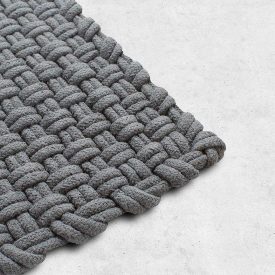 Basket Weave Rug   Client: Hem  2014  The Basket Weave rug was an intricately-woven mixture of wool and cotton, available in five colors. When designing this rug, Clabots wanted to create a minimalist piece in a single color, where the interest lay in the texture rather than the graphic.
