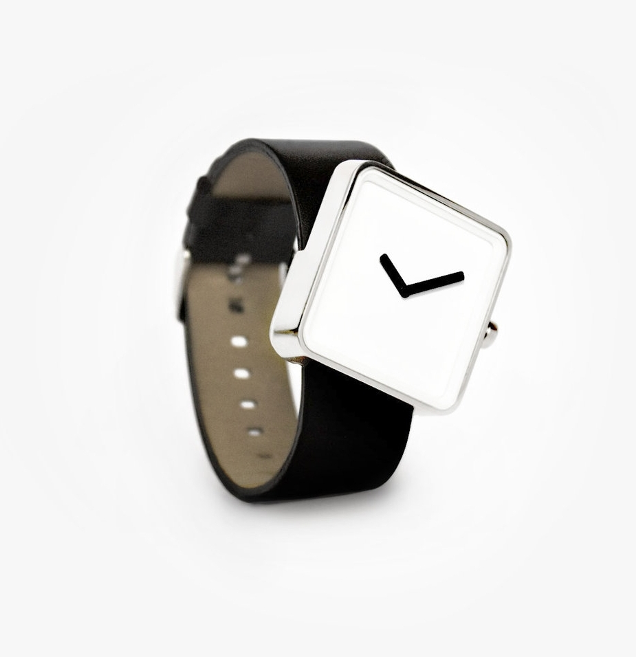 "Slip Watch    Client: Nonlinear     Slip Watch   The Slip Watch was the first product that Clabots released through Nonlinear Studio. The skewed posture of the watch put a new ""spin"" on the classic archetypal watch shape. The piece was intentionally minimal, with proportions that were almost predictable. However, its skewed posture made the watch appear to be slipping off the band, like a moment caught in time. The shape also offered increased ergonomic functionality, as the wearer could view the timepiece with less turning of the arm. The band also penetrated the casing at the 9 and 12 hour marks, giving reference to an otherwise unmarked face."