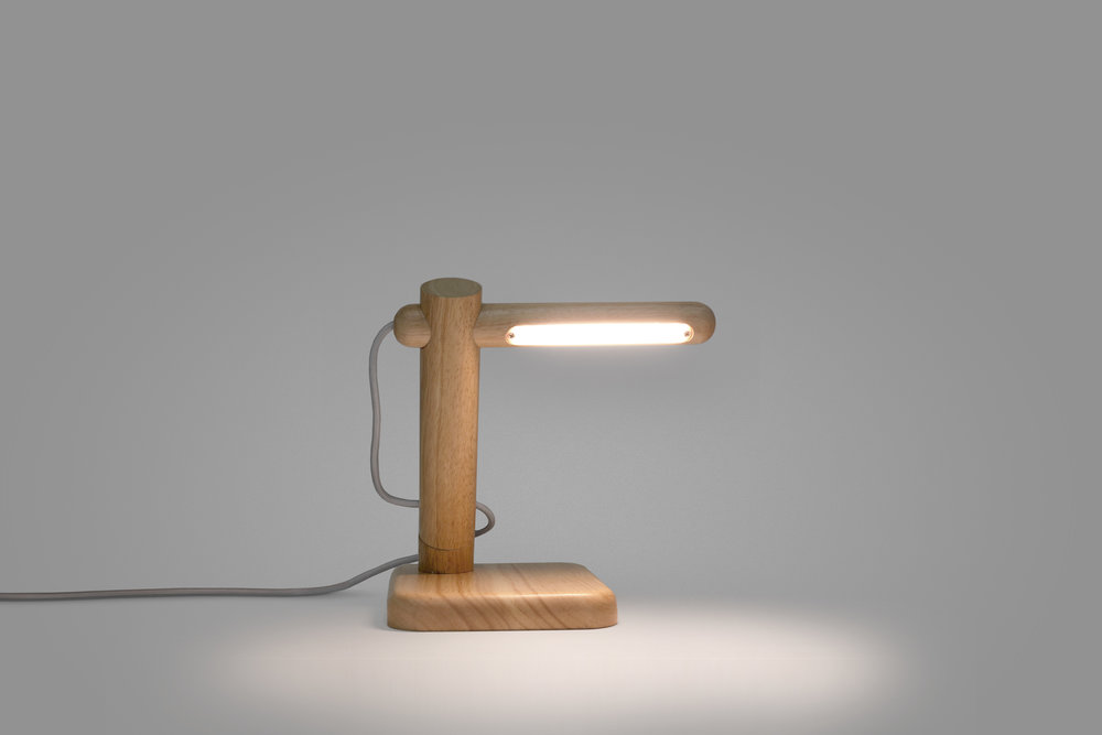 Duple Lamp   Client: Fab 2014  The Duple Lamp was a compact, sculptural wooden lamp that was equally charming when sitting on a desk or mounted on the wall. Like the rest of Fab's Nordic collection, Clabots designed it for easy assembly.