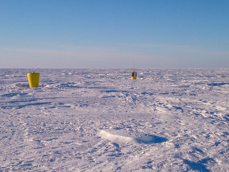 Ice tethered profiler (foreground) and Autonomous Ocean Flux Buoy (background).