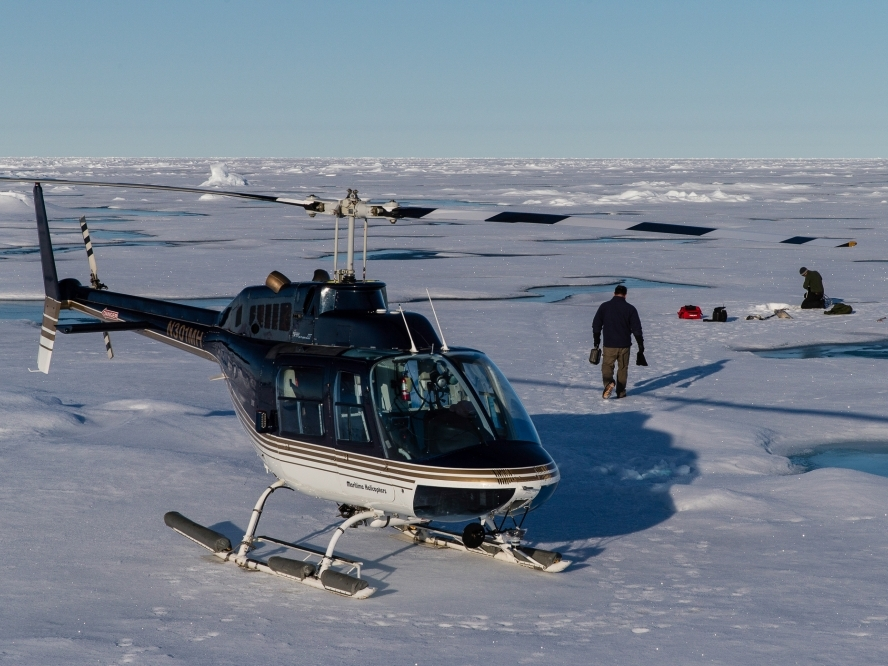 Deploying Ice Mass Balance Buoys at the northern end of the array using a Bell Jet Ranger from teh IBRV Araon.