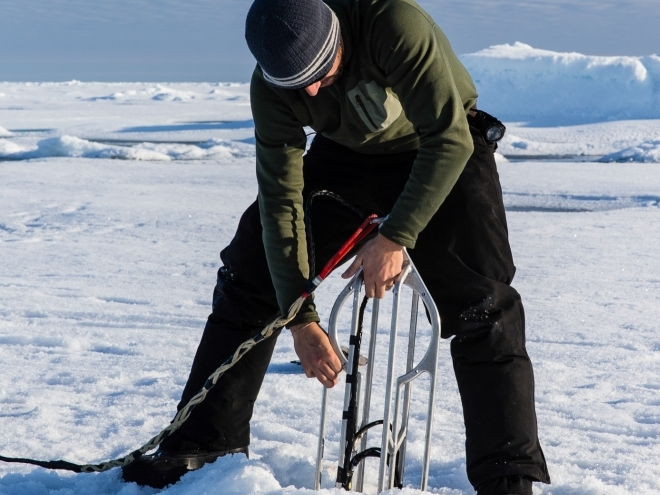 Deploying an acoustic navigation beacon through the ice.