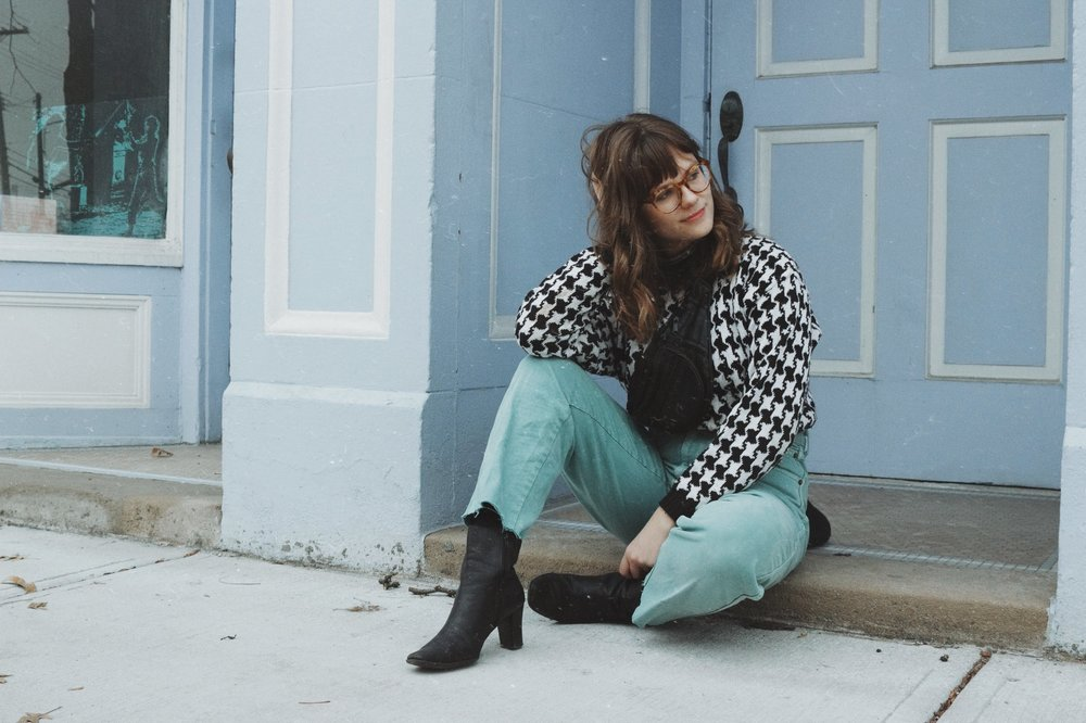 Thrifted items:  Block heel boots  Seafoam green mom jeans  Black and white sweater  Photo by  Nicole Bogdanovic
