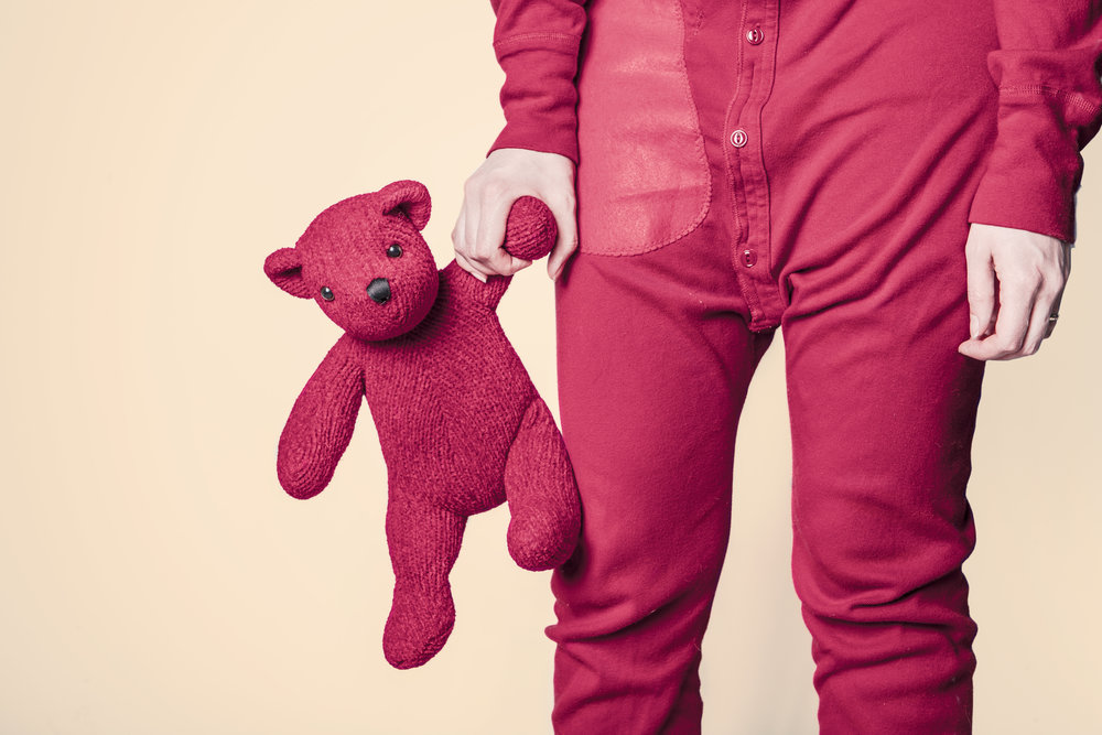 kid in PJs with red bear.jpg