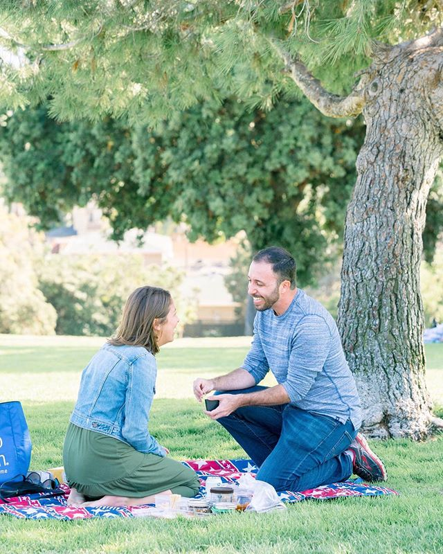I've been basking in this happiness for just over a month now... my love proposed at our favorite park with a picnic and a surprise photographer to capture the exact moment he showed me the perfect ring he picked out and asked me to marry him!! 😭😍🎉💛 My face says it all. I'm the happiest girl in the world! #justsaidyes @weddingwire 📷: @kileyshaiphotography