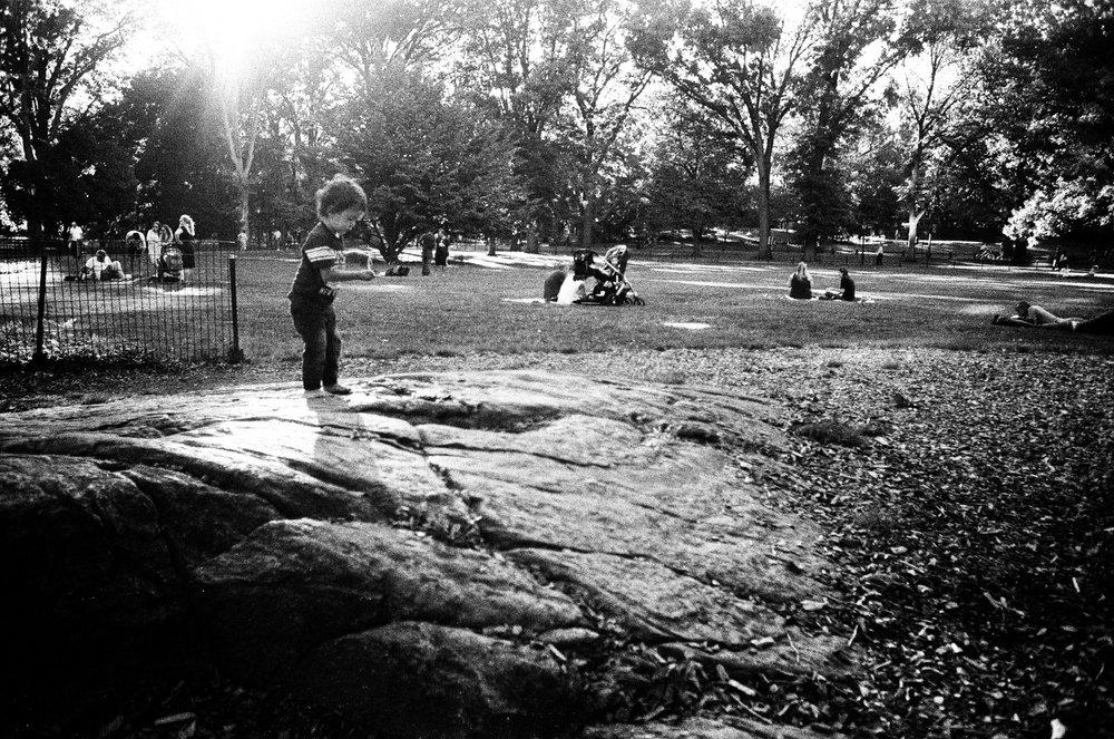 Kid_on_rock_Central_Park.jpg