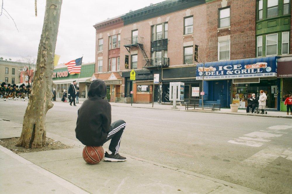 Kid_sits_on_basketball.jpg
