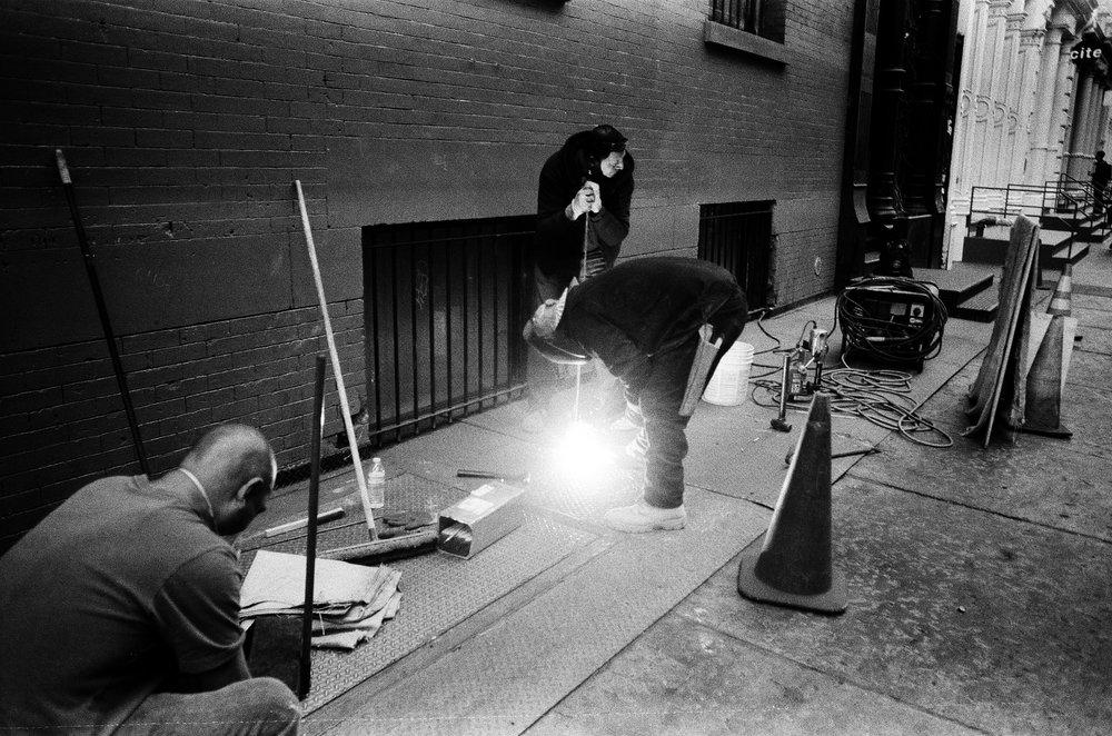 Men_working_on_sidewalk.jpg