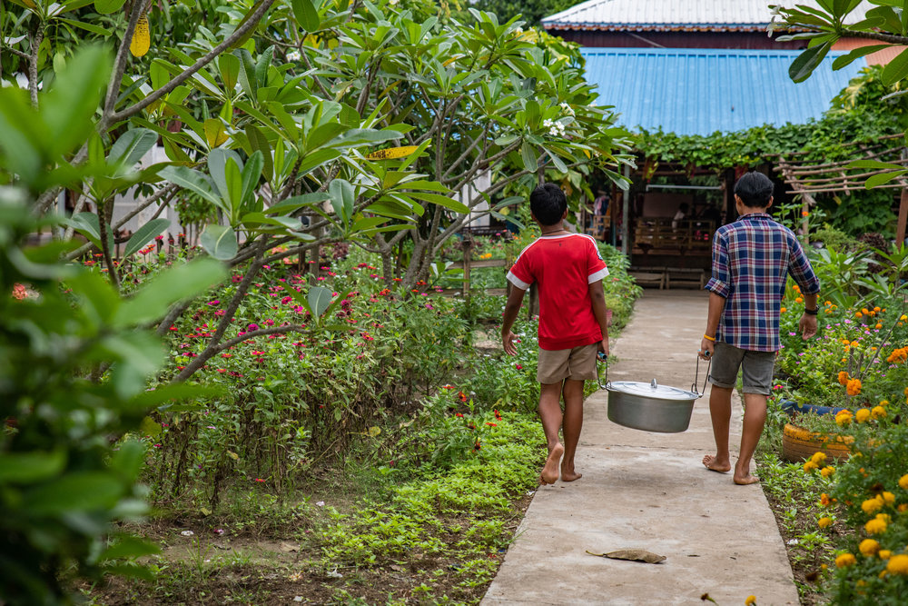 While living at the Transitional Care Facility the kids all have chores throughout the day when they aren't in class. They will gather water for meals, plant gardens, do laundry, etc. Everyone works together in a community living situation.