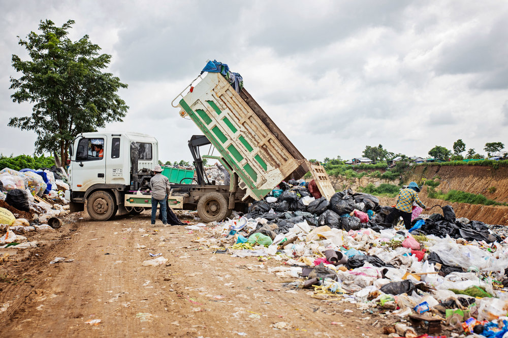 Dump trucks will come to the dump site a few times a day. As soon as the garbage is dumped out the residents will search for anything they can sell or even eat.