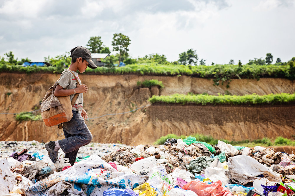 There are 17 families that live along the dumpsite. Each on of them helps to collect valuable trash. Kids as young as 3 years old help their parents collect trash to sell back.