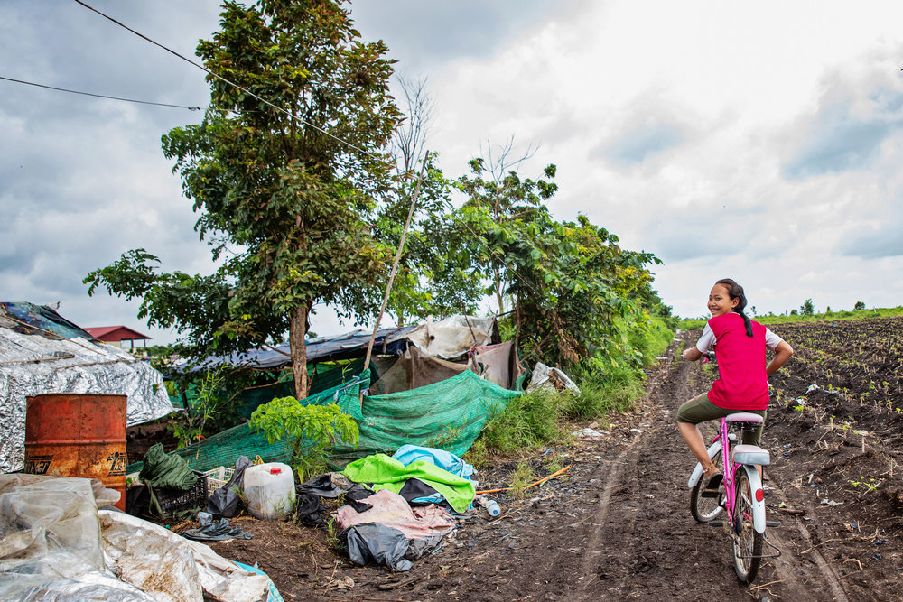 Coming back from her morning program at Damnok Toek to work at the dump site with her family.