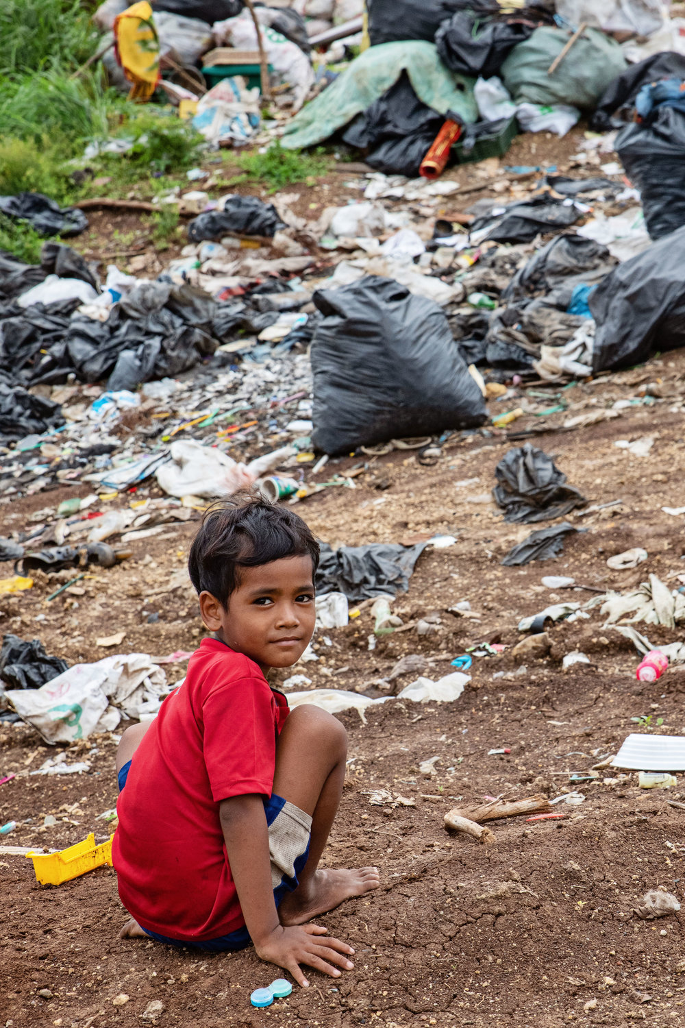 Kids live and play amongst the garbage every day.