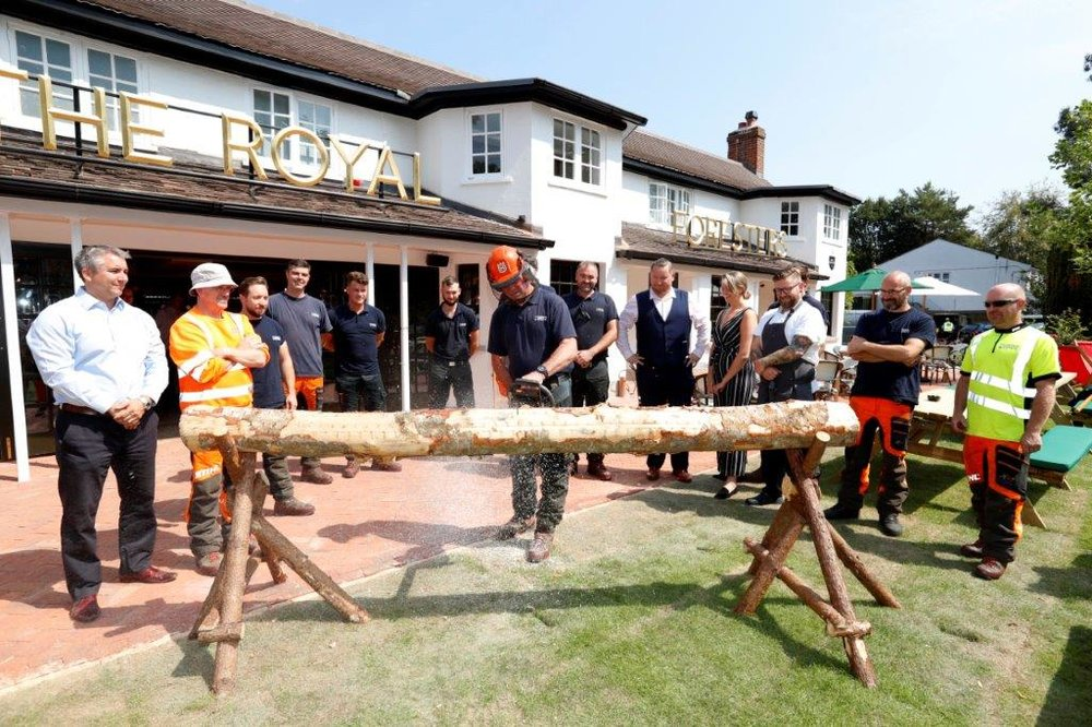 Royal Foresters pub being officially opened by Royal Forester Russell Sturgess and his chain saw v1.jpg