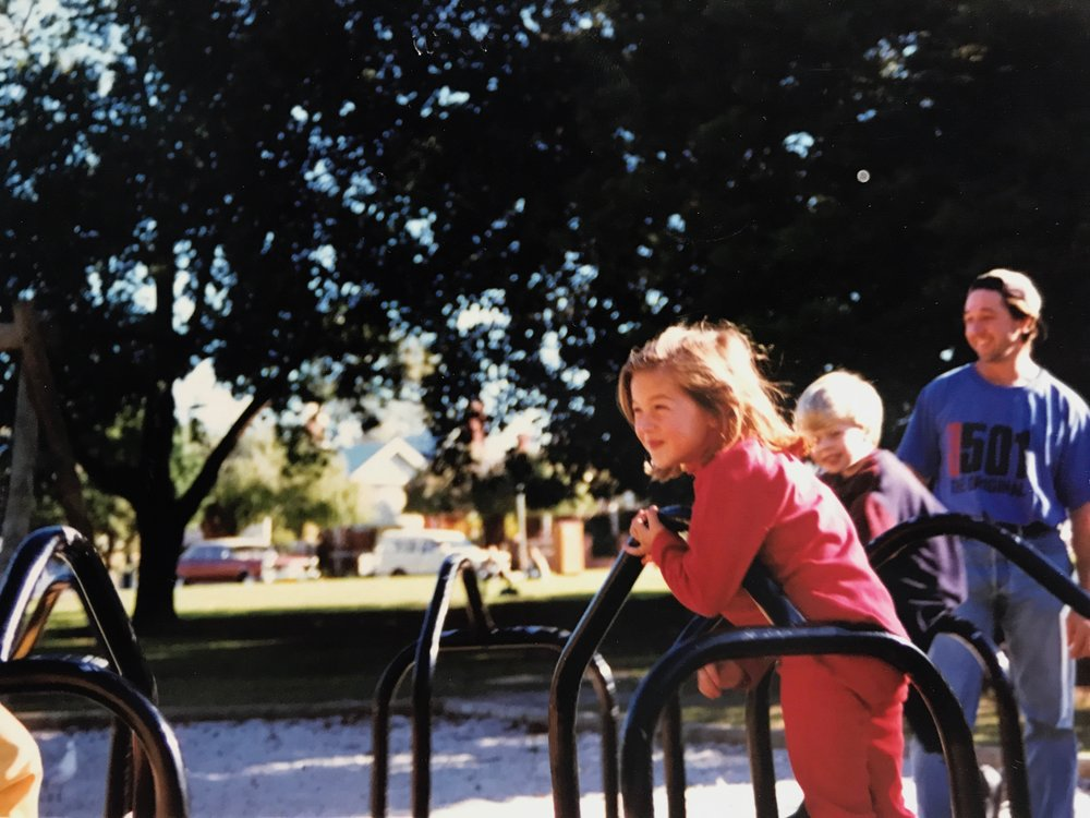 Flashback to the 90's - playing on the playground with my dad and brothers at the local park.