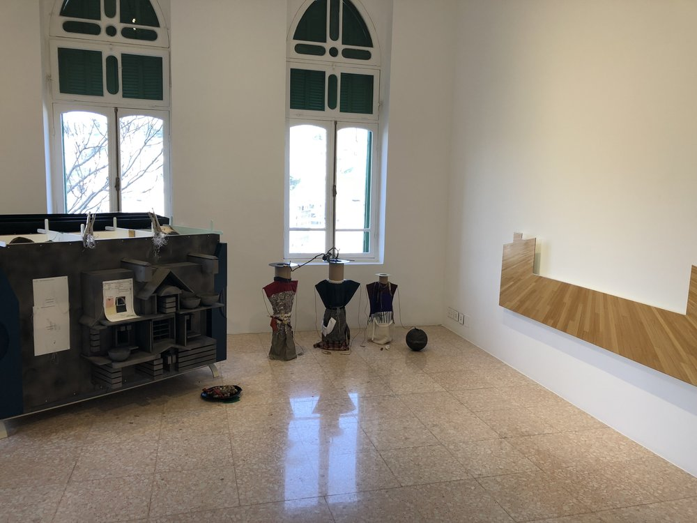 Helen Marten's 'Seeds' on left, and Walid Raad's wood panel titled 'Section 88_Act VI_Plate 1