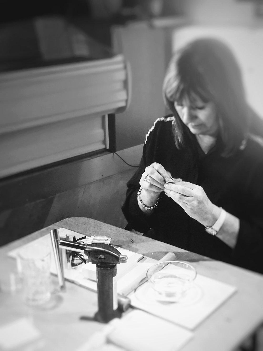 polishing a silver ring.jpg
