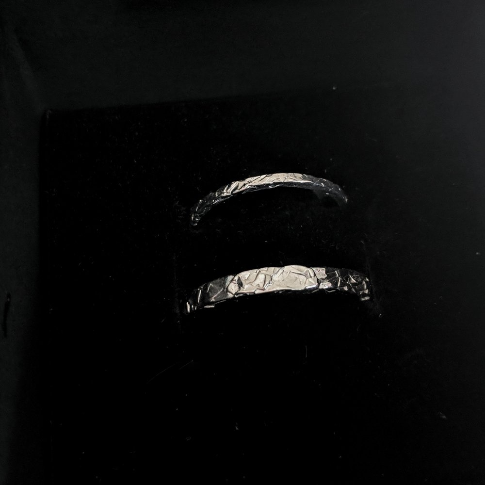 9ct white gold textured wedding rings in box.jpeg