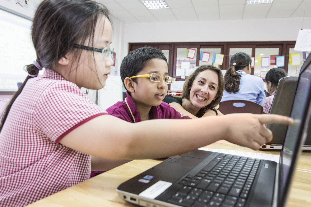Student interacting with a teacher in a class of BIS | Hong Kong Prospectus School Photographer Francis Roux |