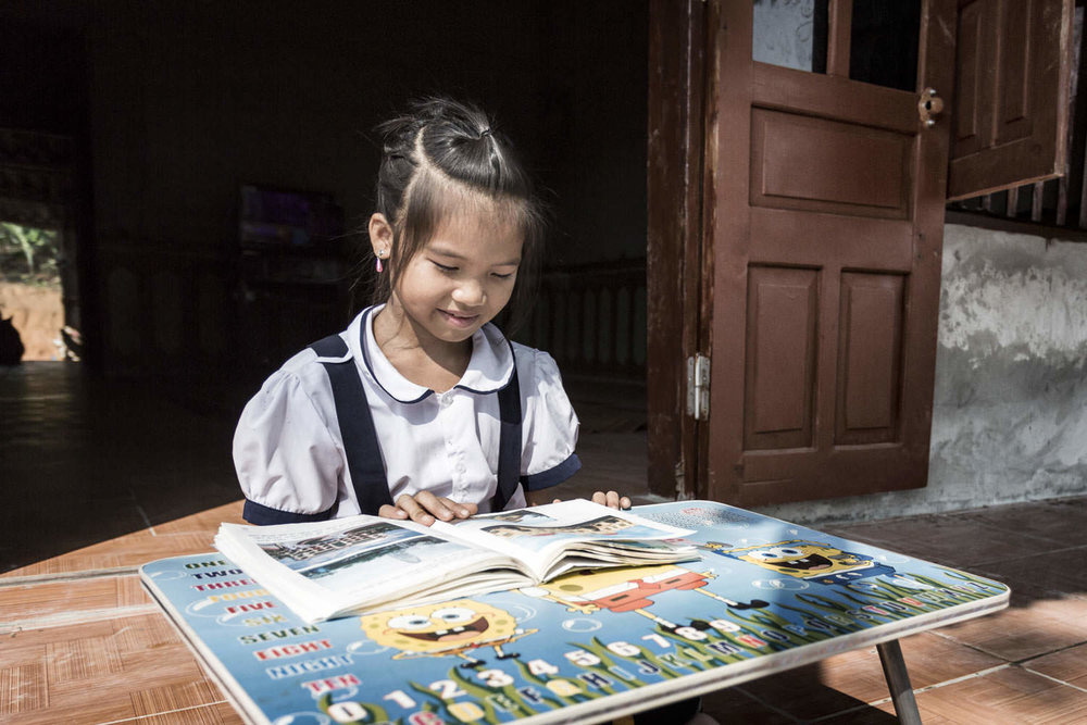 Portrait of a young girl doing homework | Habitat for Humanity | Vietnam NGO Documentary | Francis Roux